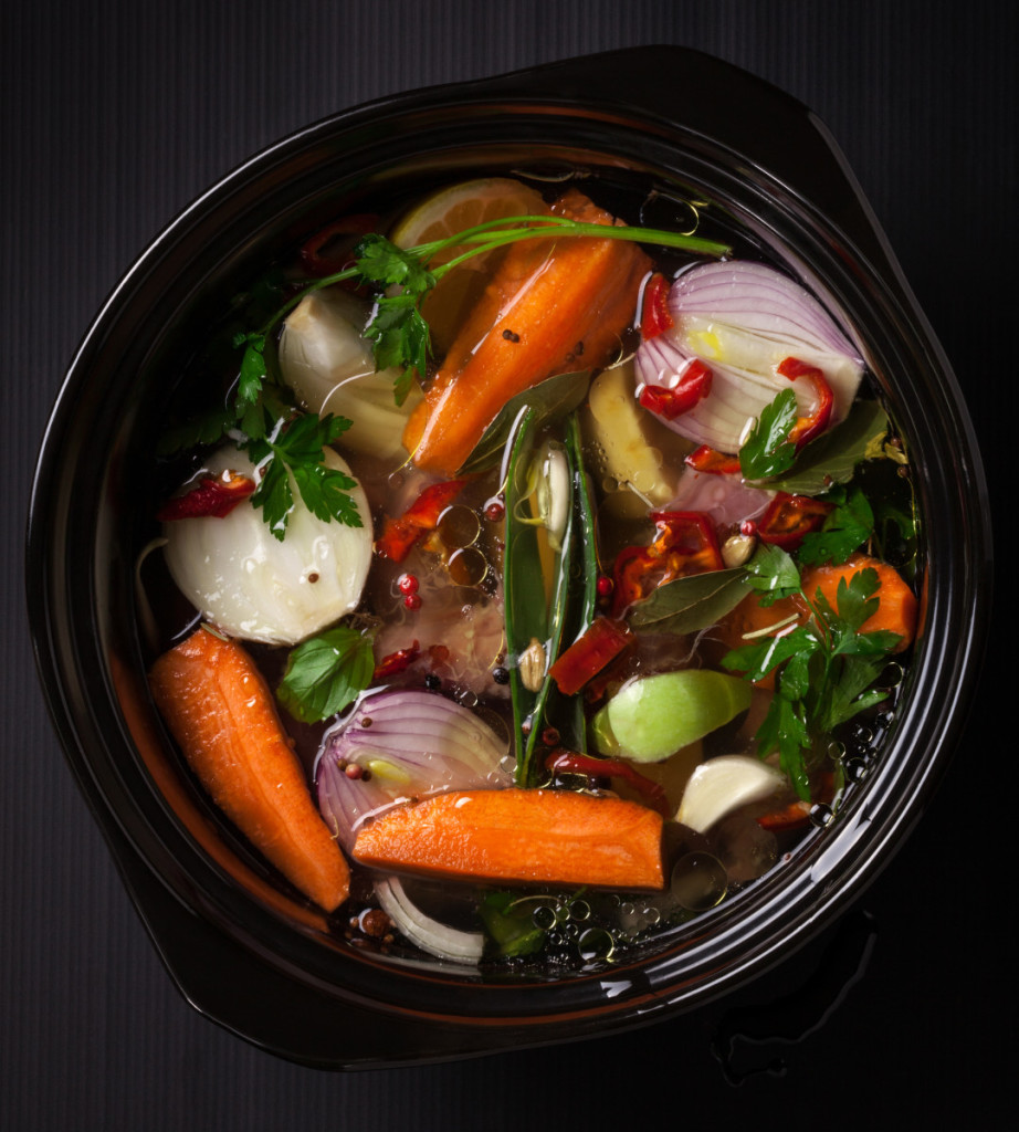 fresh-vegetable-soup-in-a-pot-on-black-background